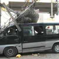 Passenger Vans Electric Pole Hit
