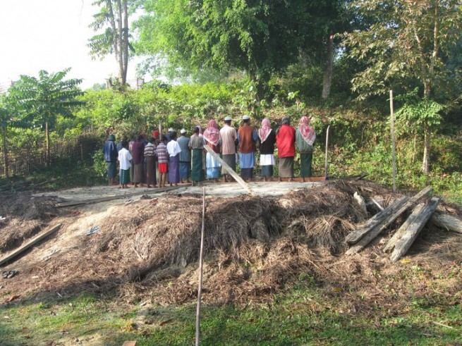 A few remaining Rohingyas in a village of Maungdaw town praying on the mosque's ground after the mosque was demolised.