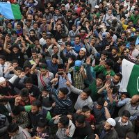 Kashmiri Leader waves Pakistani Flag