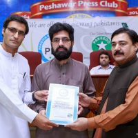 Rehmat Aziz Chitrali Receiving Certificate