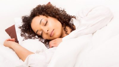 African woman slepping in bed