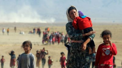 Yazidi woman with her children
