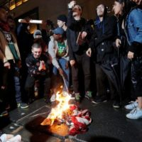 Protesters Burn U.S. Flag