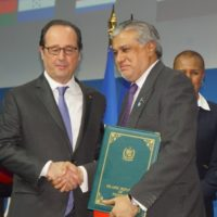 Ishaq Dar handin over the Letter of Intent at OPG Summit