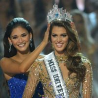 Miss Universe contestant Iris Mittenaere (R) of France is crowned the new 2017 winner