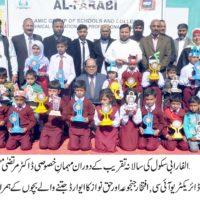 Dr. Murtaza Mughal with School Children