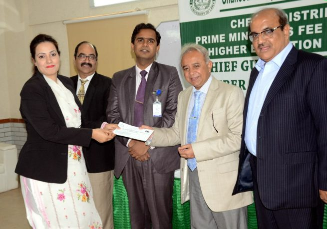 Dr GR Bhatti Giving Check