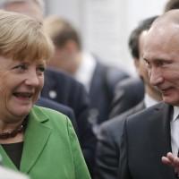 Vladimir Putin with Angela Merkel