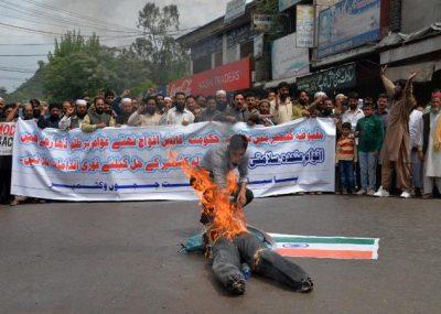 Protesters burn Modi