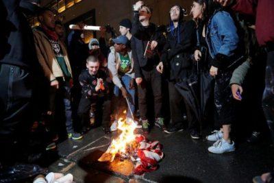 Protesters Burn  U.S. Flag