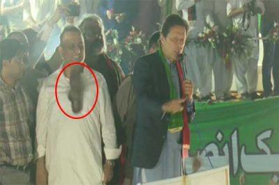 Attempting to throw shoe at Imran Khan